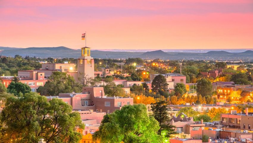 Skyline of Santa Fe with mountains in background at sunset