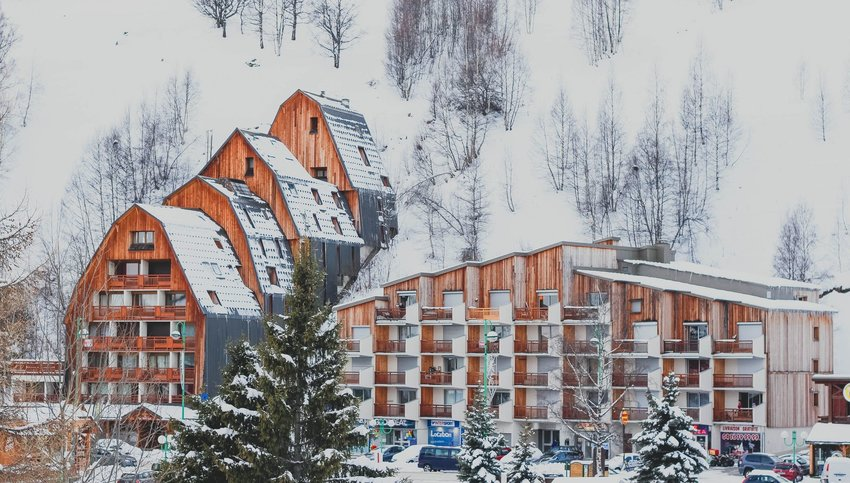 Hotel buildings covered in snow on snowy hillside