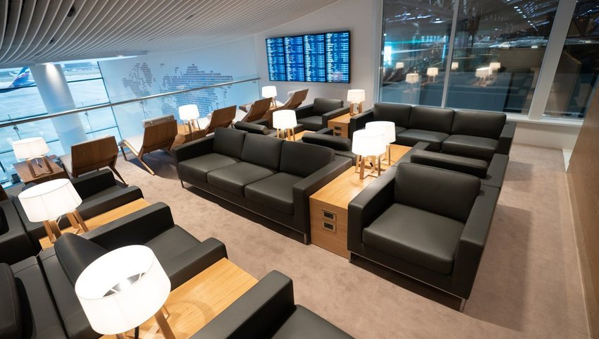Airport lounge with large plush chairs and lights
