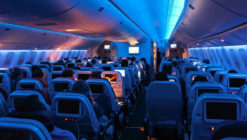 Interior of plane with lights dimmed in cabin