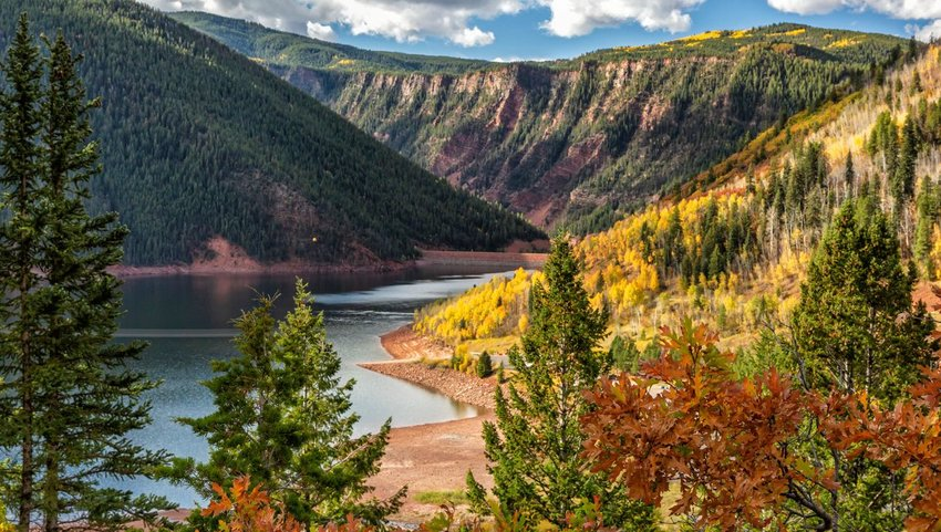 Fryingpan river running through mountains with fall colored trees