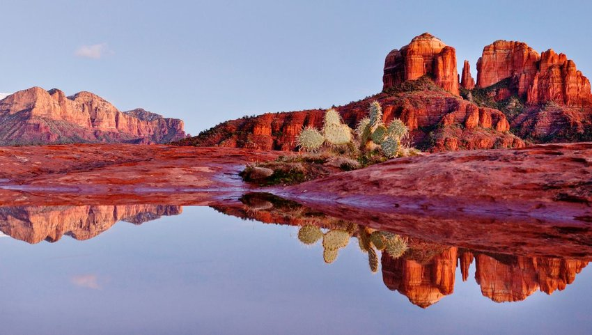 Reflection of red rocks landscape in water