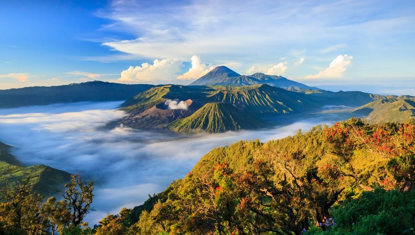 Mount Bromo volcano surrounded by clouds in Surabaya, Indonesia