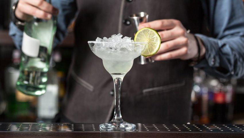 Bartender mixing a margarita