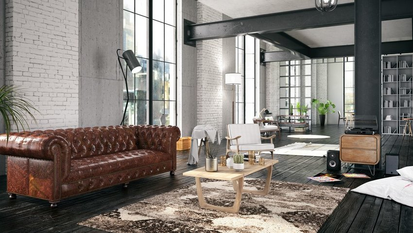 Interior of loft with leather couch and wood furniture