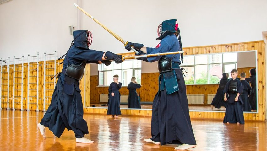 Two people Keno sword fighting