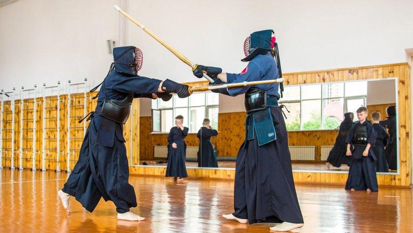 Two people Keno sword fighting