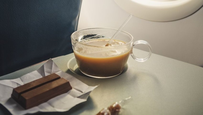Coffee and chocolate on airplane tray