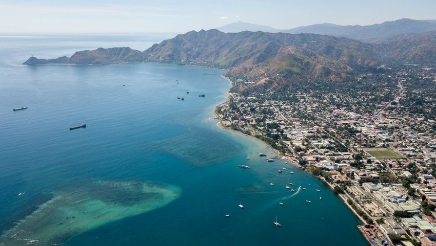 Aerial view of Dili with boats in the harbor