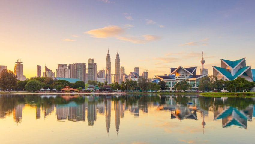 Panoramic view of Kuala Lumpur city waterfront skyline with reflections