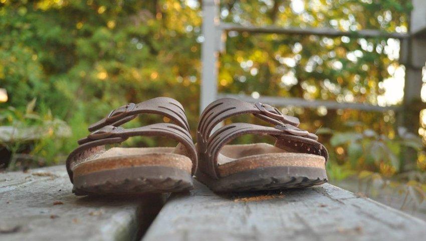 Pair of Birkenstock sandals sitting on steps