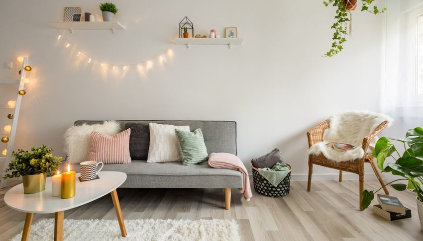 String lights, candles and plants in living room