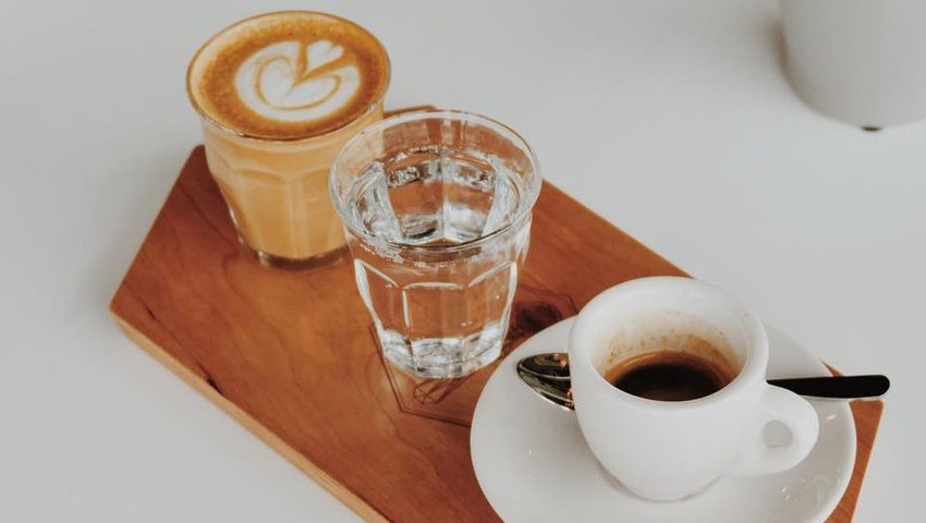 Coffee sitting on a wooden platter