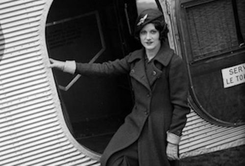 Ellen Church standing in front of an open plane door, circa 1930