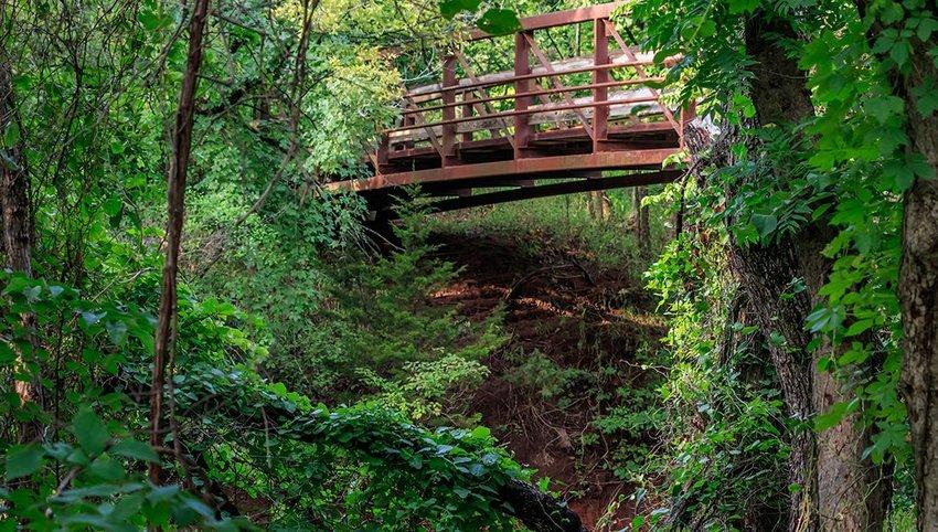 Wooden bridge in a lush green Oklahoma setting