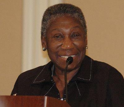 Barbara Hillary speaking from a podium
