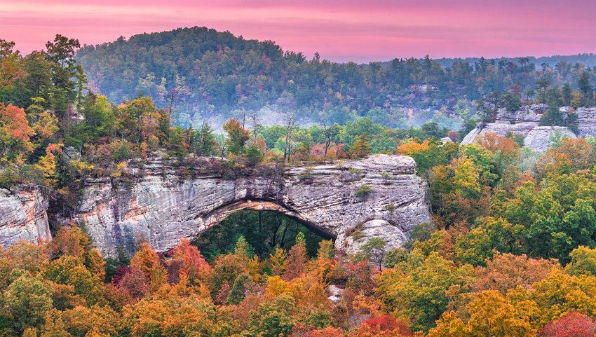 Daniel Boone National Forest, Kenucky, USA at the Natural Arch at dusk in autumn