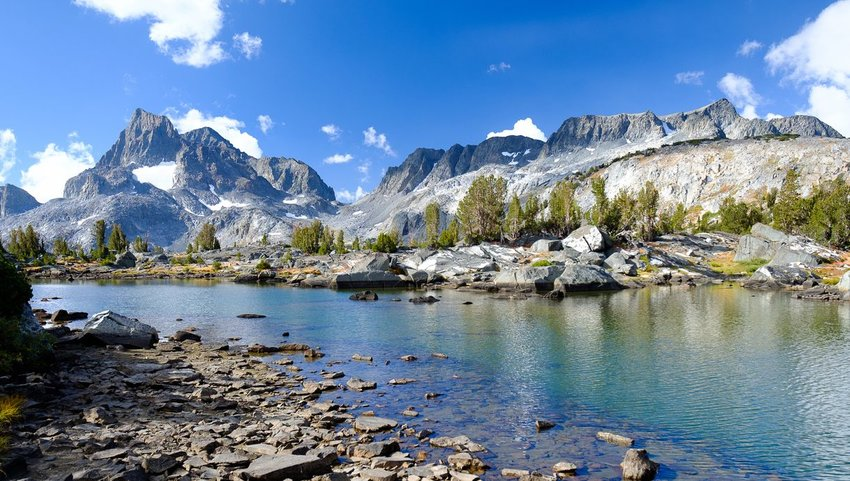 The Sierra Nevadas with stream in front on the John Muir Trail
