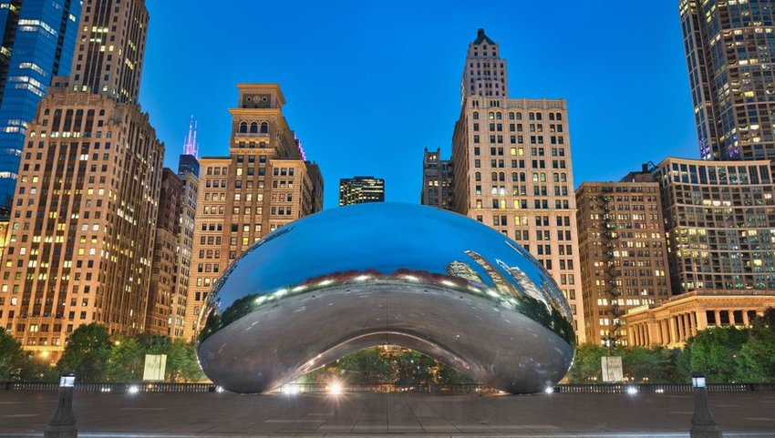 Cloud Gate in Chicago with buildings in the background