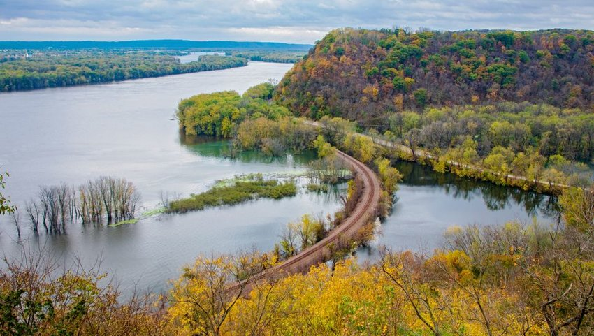 Above Mississippi river and woodlands during autumn at Iowa border
