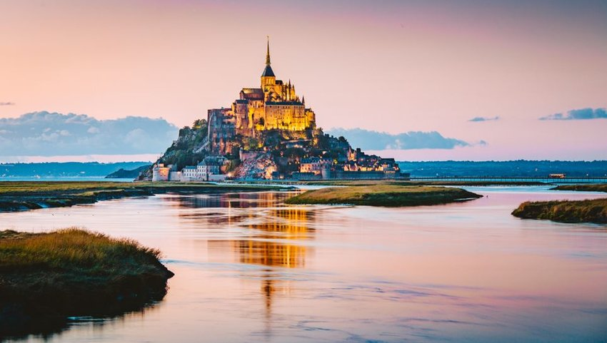 Le Mont Saint-Michel tidal island at dusk, Normandy, northern France