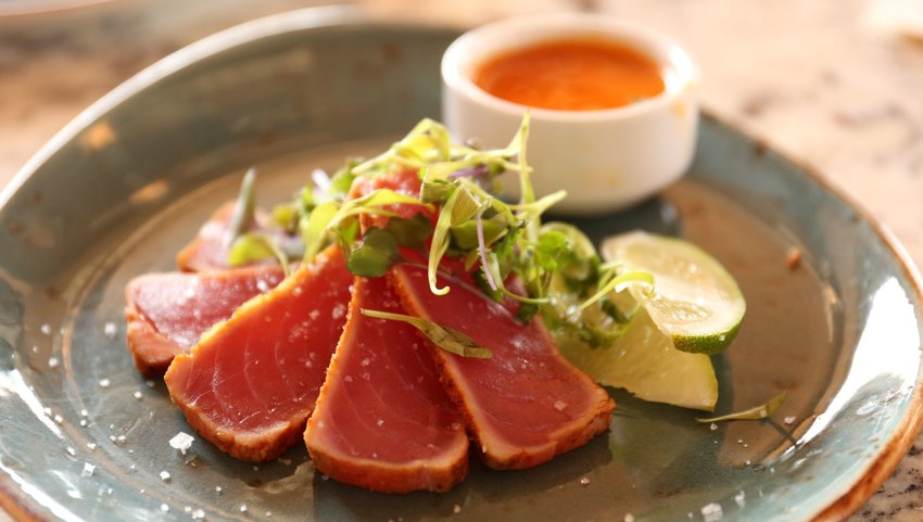 Raw fish on plate with sauce
