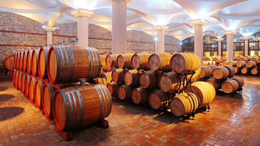 Wine barrels in a wine cellar in the Tikvesh winery region.