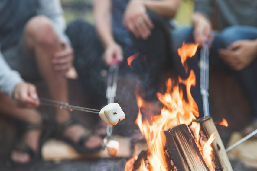 Roasting marshmallows over a fire